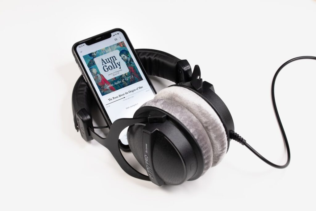 Headphones playing background music for audiobooks