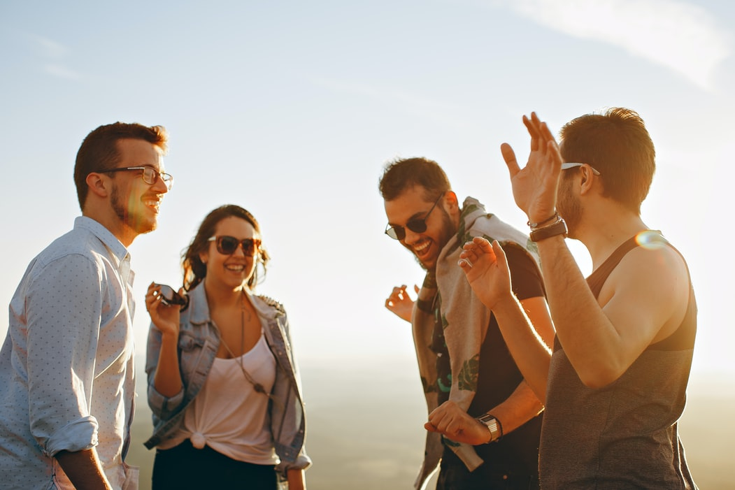 Group of people listening to happy background music for videos in mp3