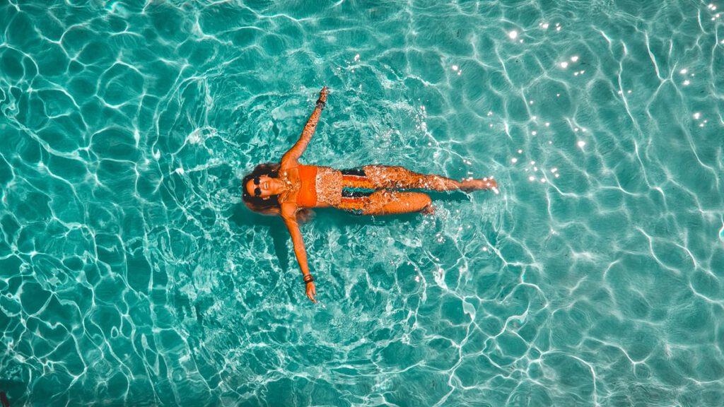 Women swimming with music