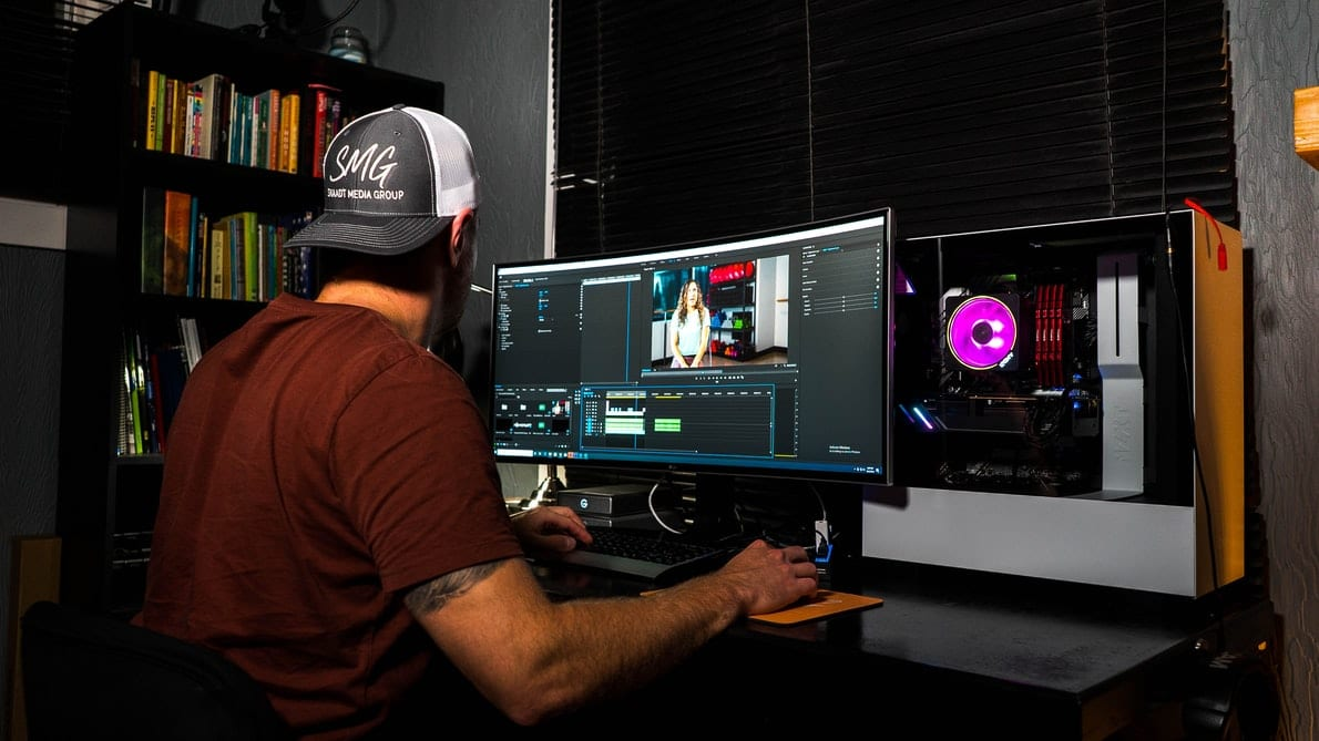 Man editing video for rewarded video ad networks