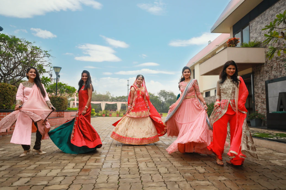 Indian girls dancing to background music for Indian wedding video